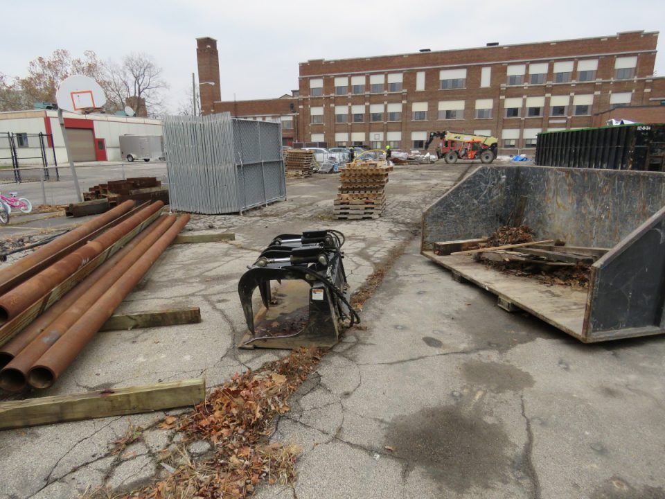 The west parking lot of the old middle school in St. Clair is littered with construction materials and random equipment.