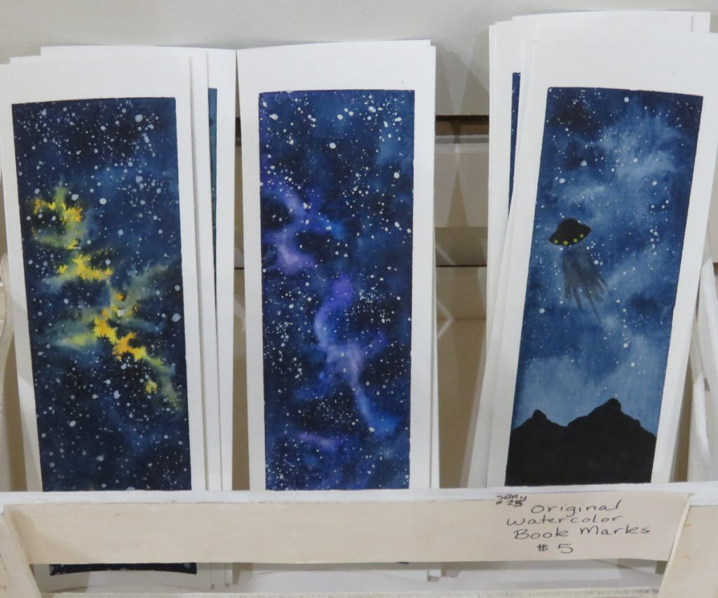 Hand-painted bookmarks feature the galaxy a $5 each.