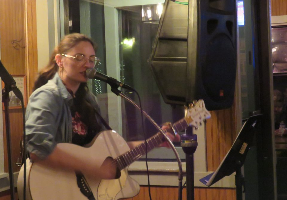 Stef Ray playing her winning song at LaCroix's Riverside Tavern.