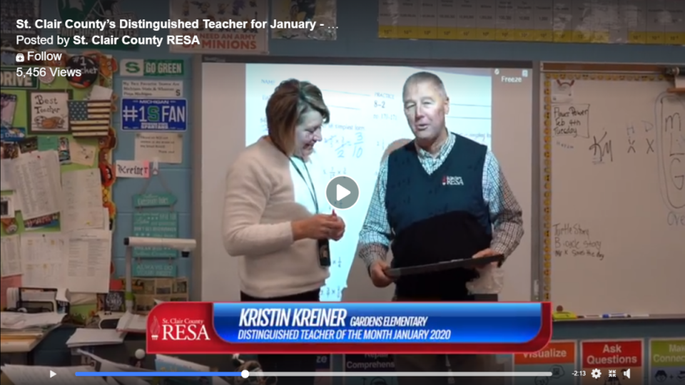 Kristin Kreiner accepts the Distinguished Teacher award from Kevin Miller, superintendent of St. Clair County RESA.