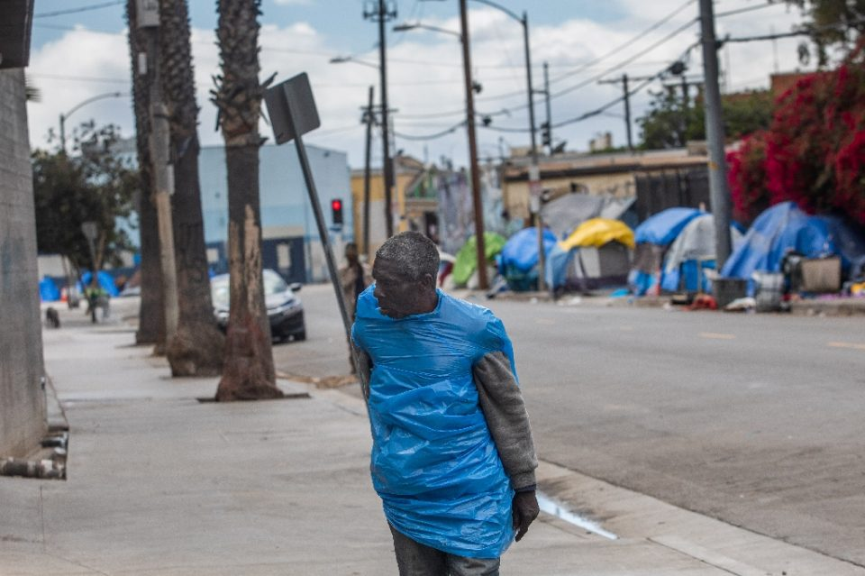California's homeless population of 150,000 is the largest in the nation, some 60,000 of whom live in Los Angeles County - like this man on San Julian Street in the Skid Row area in downtown Los Angeles - Apu GOMES / ©AFP