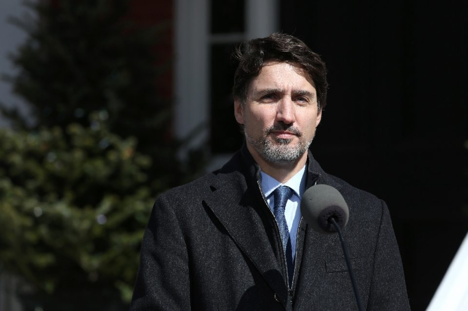 "Canadian Prime Minister Justin Trudeau (pictured March 16, 2020) also urged all Canadians living abroad to ""come home"" - Dave Chan / ©AFP"