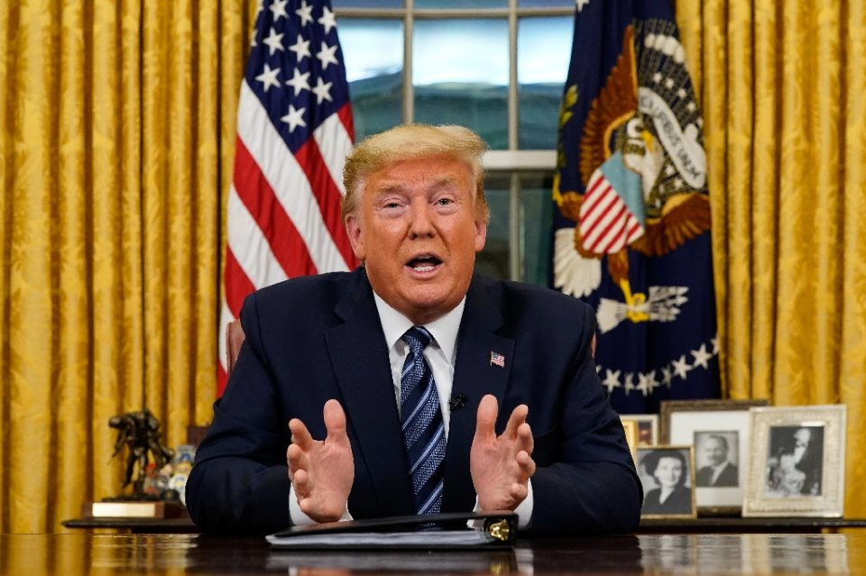 US President Donald Trump addresses the Nation from the Oval Office about the widening novel coronavirus (Covid-19) crisis (AFP Photo/Doug Mills)