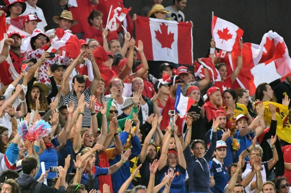 Canadian fans wave national flags before a women's rugby sevens game at the 2016 Rio Olympics - Pascal GUYOT / ©AFP