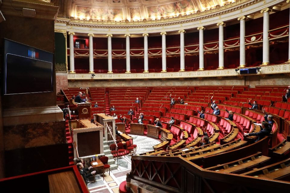 Only a handful of lawmakers were physically present to pass the legislation - Ludovic MARIN / ©AFP