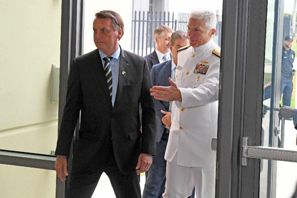 Brazilian President Jair Bolsonaro(C), is greeted by Commander, US Southern Command Admiral Craig Faller(R) in Miami, Florida on March 8, 2020; Brazil's leader was there to discuss growing bilateral defense-cooperation partnership - Gaston De Cardenas / ©AFP