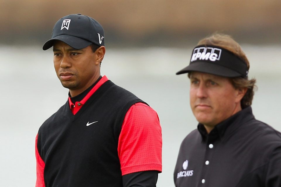Tiger Woods, left, and Phil Mickelson are in talks for a two-on-two golf match with NFL star quarterbacks Tom Brady and Peyton Manning as partners, according to multiple reports Wednesday - EZRA SHAW / ©AFP