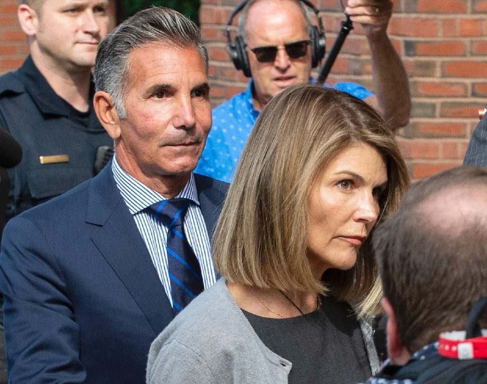 Actress Lori Loughlin and husband Mossimo Giannulli, shown here in August 2019, switched their previous pleas of innocence to guilty in a bid to lighten their sentences for conspiracy to commit fraud - Joseph Prezioso / ©AFP