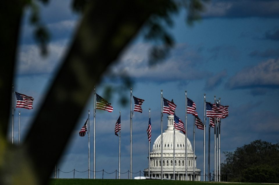 US President Donald Trump has ordered flags at US monuments and federal buildings, such as these shown at the Capitol in Washington, lowered to half-staff - Eric BARADAT, Eric BARADAT / ©AFP