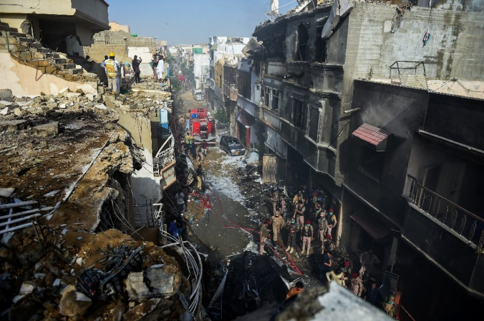 The plane was close to landing when it came down among houses, sparking an explosion and killing several people on the ground (AFP Photo/Rizwan TABASSUM)