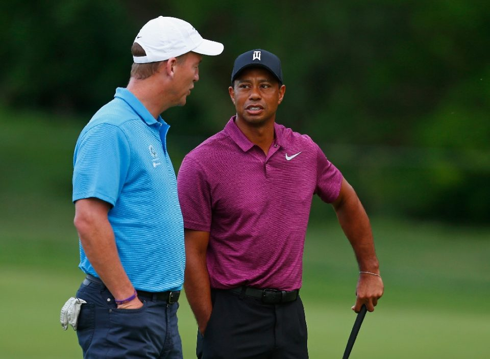 Tiger Woods and Peyton Manning chat during the 2018 Memorial Tournament pro-am, the two will team up to take on Phil Mickelson and Tom Brady in a charity match for COVID-19 relief - Matt SULLIVAN / ©AFP