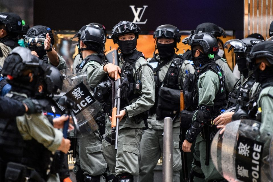Riot police position themselves in Hong Kong in May 2020 as the city legislature debated a law that bans insulting China's national anthem - ANTHONY WALLACE / ©AFP
