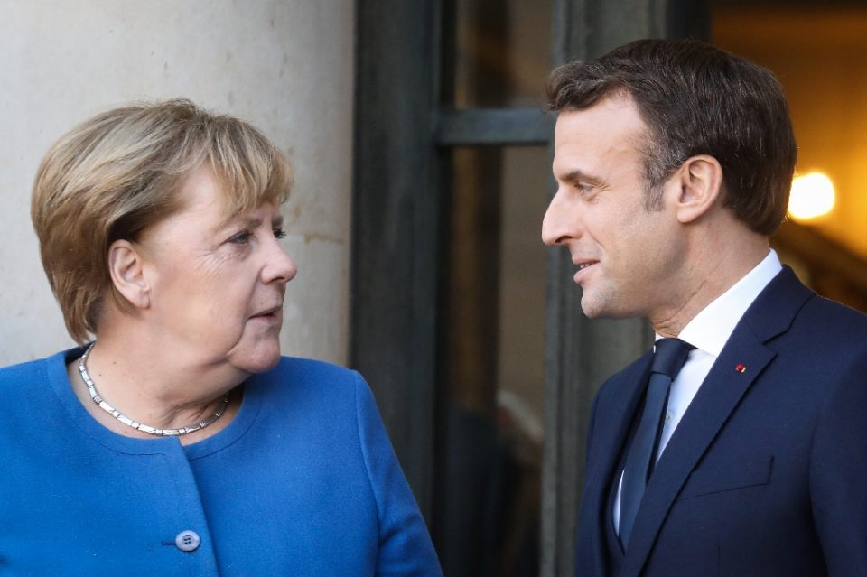 German Chancellor Angela Merkel and France's Emmanuel Macron will meet on Monday with some weighty issue at stake (AFP Photo/LUDOVIC MARIN)