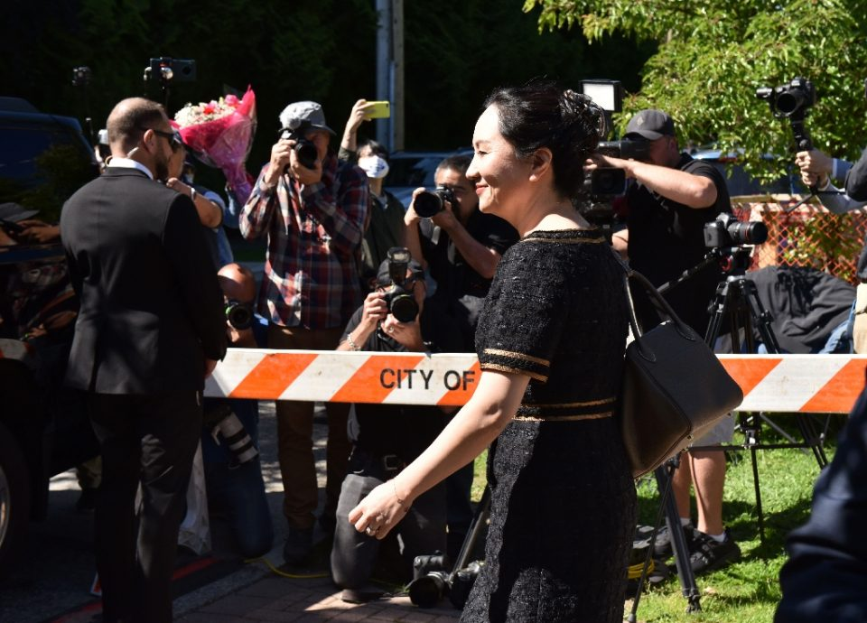 """""""Defense lawyers for Chinese Huawei tech executive Meng Wanzhou, seen here leaving her Vancouver home for court in May, allege her arrest on a US extradition warrant was not lawful - Don MacKinnon / ©AFP"""""""