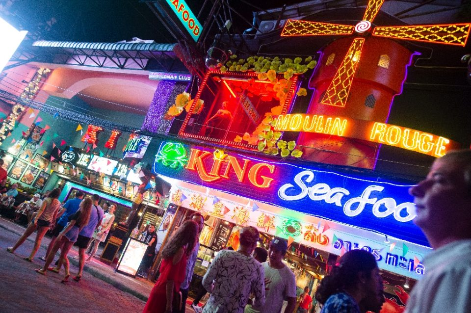 Bars and massage parlours in ares such as Pattaya's infamous Walking Street will be allowed to reopen under eased coronavirus lockdown restrictions (AFP Photo/Romeo GACAD)