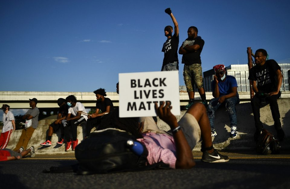 "Massive nationwide protests over the death of George Floyd, an unarmed African American who was heard saying ""I can't breathe"" as he suffocated with an officer's knee on his neck were followed by nationwide protests (AFP Photo/Brendan Smialowski)"