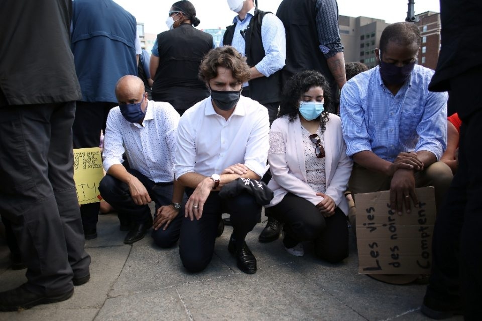Canadian Prime Minister Justin Trudeau, seen taking a knee during a Black Lives Matter protest in Ottawa in June 2020, pledged Can$221 million to support black entrepreneurs who have historically faced barriers to obtaining bank loans - Dave Chan / ©AFP
