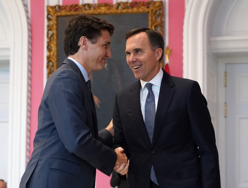 Canadian Prime Minister Justin Trudeau (L, pictured November 2019) and Finance Minister Bill Morneau have apologized for not recusing themselves from the negotiations on the contract awarded to WE Charity (AFP Photo/Chris Wattie)
