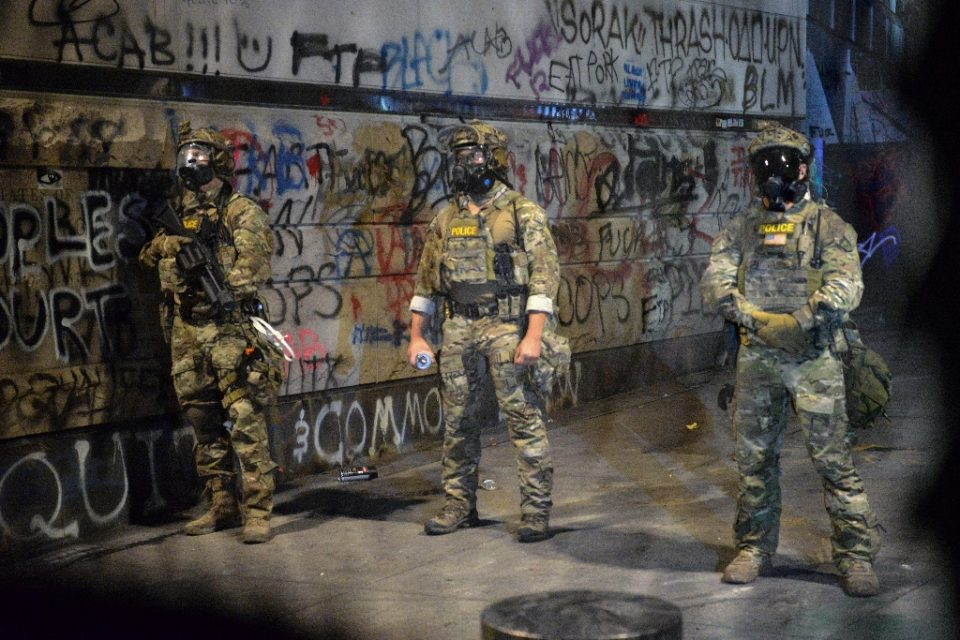 Federal officers pictured in Portland, Oregon on July 25, 2020 -- the city has been rocked by weeks of clashes between demonstrators and law enforcement (AFP Photo/Ankur Dholakia)