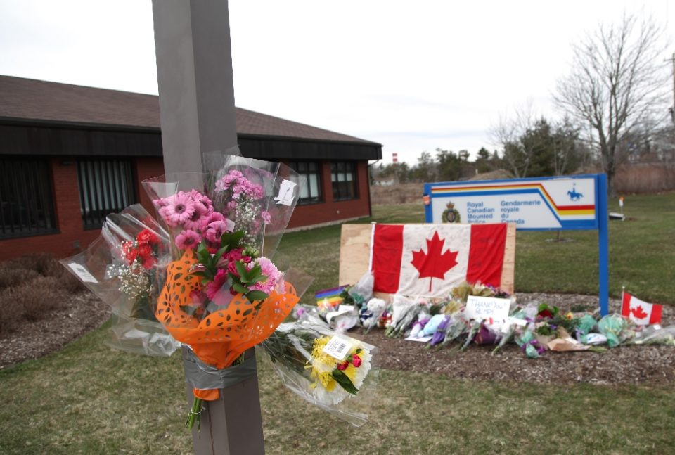 An impromptu memorial (pictured April 2020) sits in front of the home detachment of slain RCMP Constable Heidi Stevenson, who was one of the people killed during Canada's worst-ever mass shootings (AFP Photo/Tim Krochak)
