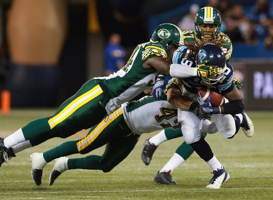 The Edmonton Eskimos team will soon change their name, but no news on whether they will keep their green and yellow uniforms (AFP Photo/DAVE SANDFORD)
