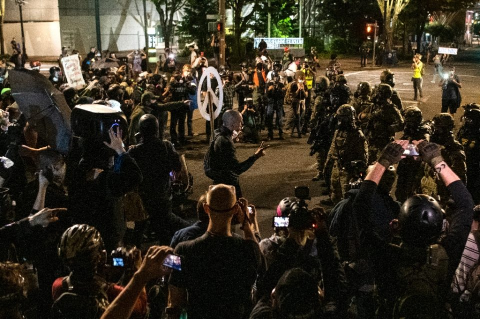 Demonstrators confront law enforcement during a protest against racial injustice, police brutality and the deployment of federal troops to US cities on July 29, 2020 in Portland, Oregon (AFP Photo/Alisha JUCEVIC)