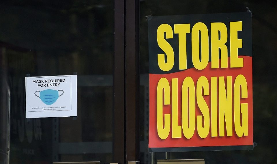 More businesses have had to shut down again as virus cases rise, undermining the nascent US recovery (AFP Photo/Olivier DOULIERY)