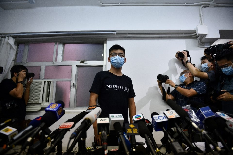 Hong Kong pro-democracy dissident Joshua Wong slammed authorities for disqualifying activists from being candidates in September's legislative elections (AFP Photo/Anthony WALLACE)