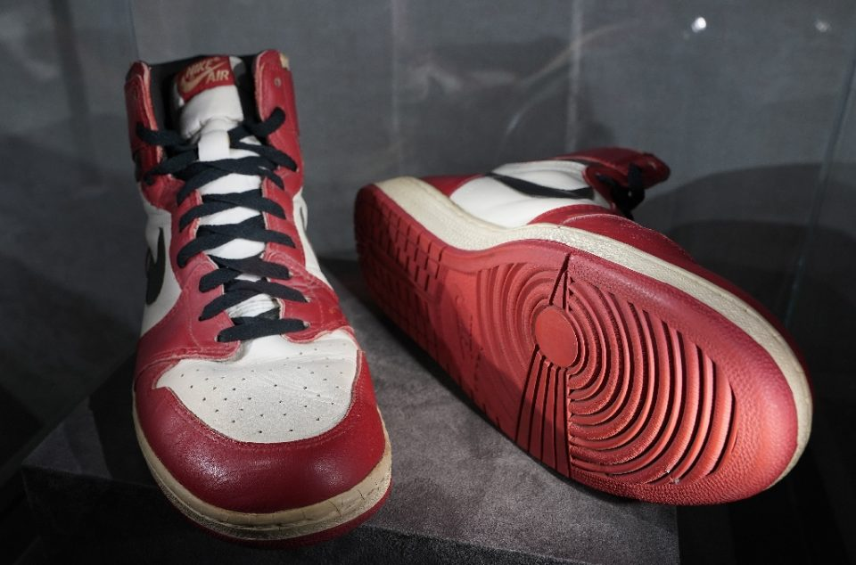 The Air Jordan 1 High, which Michael Jordan wore when he smashed the net's glass backboard during an exhibition game in Italy in 1985, are expected to sell for up to $850,000 at auction (AFP Photo/TIMOTHY A. CLARY)