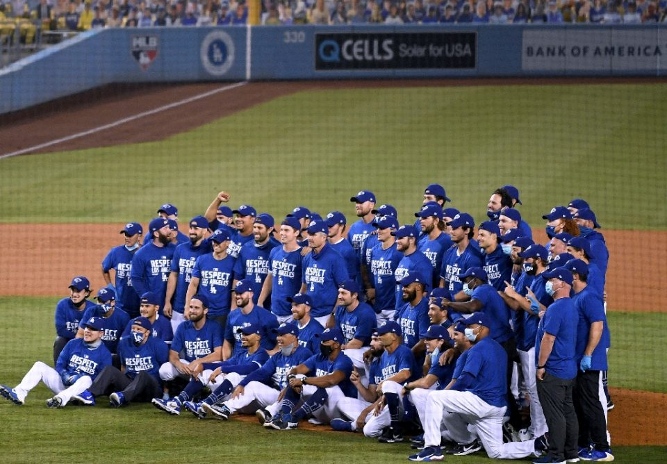 The Los Angeles Dodgers celebrate after clinching an eighth straight National League West division title with a 7-2 win over Oakland on Tuesday - Harry How / ©AFP