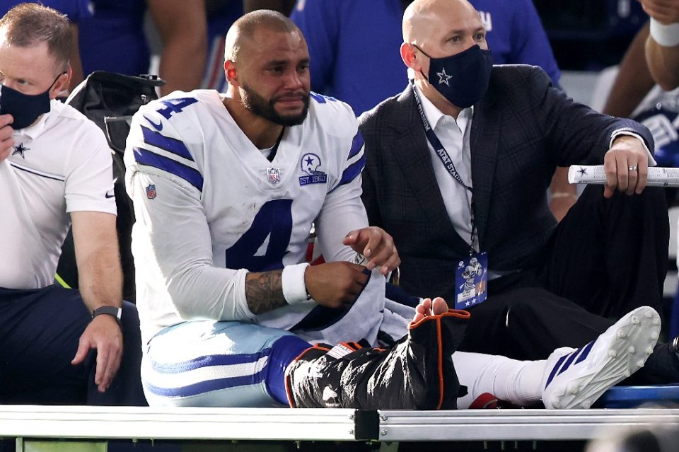Dallas Cowboys quarterback Dak Prescott is carted off the field after suffering a broken and dislocated right ankle last Sunday against the New York Giants - TOM PENNINGTON / ©AFP