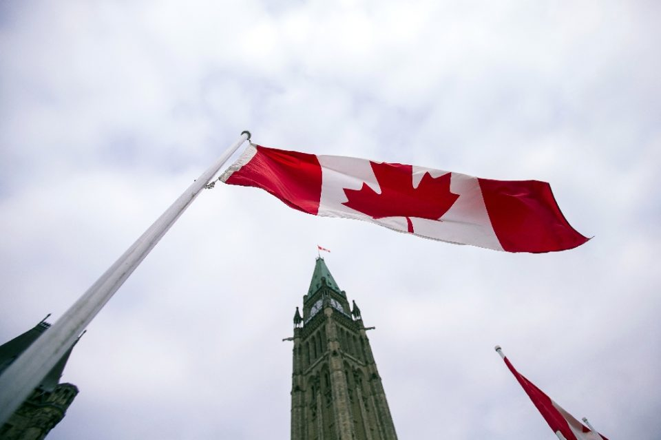 Canada's unemployment rate fell to 8.9 percent in October as the economy added 84,000 jobs, but further gains were dampened by new Covid-19 lockdowns; in a 2015 file image a Canadian flag flies in front of the peace tower on Parliament Hill in Ottawa - GEOFF ROBINS / ©AFP