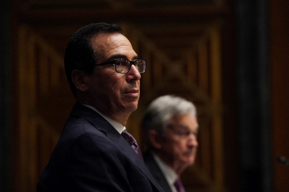 Treasury Secretary Steven Mnuchin and Federal Reserve Chair Jerome Powell in background have disagreed on whether emergency lending programs should be extended - POOL / ©AFP