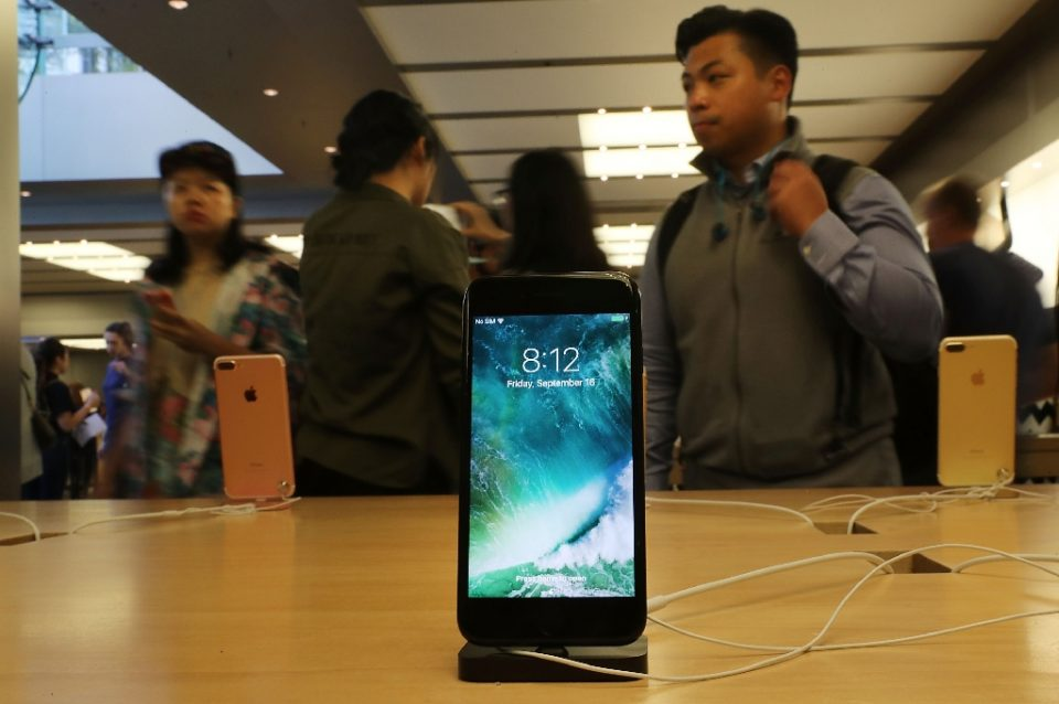 Apple agreed to a new settlement on allegations that it slowed the performance of older devices such as the iPhone 7 to manage insufficient battery capacity - SPENCER PLATT / ©AFP