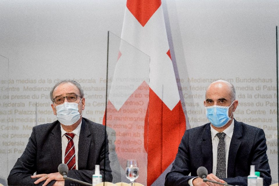 Swiss President Guy Parmelin and Health Minister Alain Berset spoke of the new restrictions with a plexiglass divider between them - Fabrice COFFRINI / ©AFP