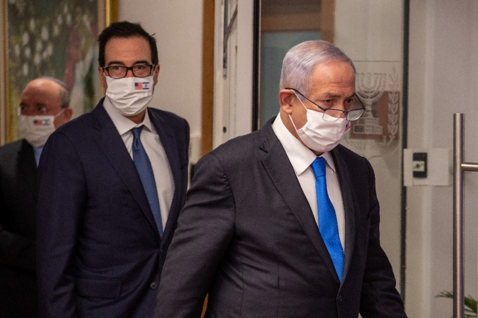 """Israeli Prime Minister Benjamin Netanyahu condemns as """"disgraceful"""" violence on the US Capitol by supporters of staunch ally President Donald Trump; visiting US Treasury Secretary Steve Mnuchin calls it """"unacceptable"""" - Emil SALMAN / ©AFP"""