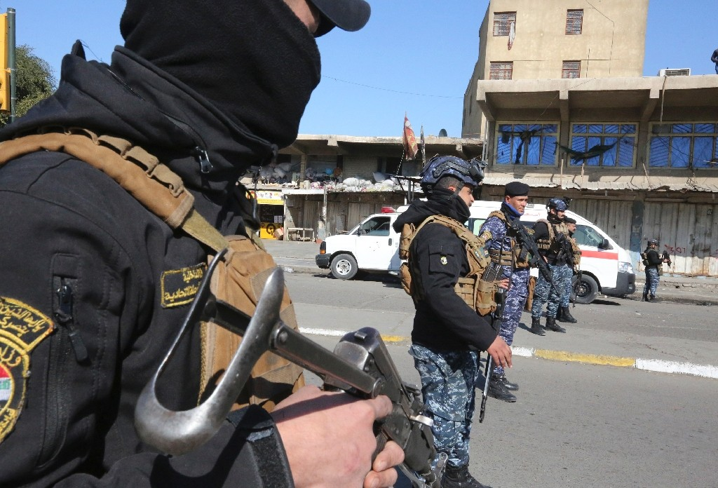 Security forces stand guard after twin suicide blasts killed at least 32 people and wounded more than 100 in Baghdad on January 21, 2021 - Sabah ARAR / ©AFP