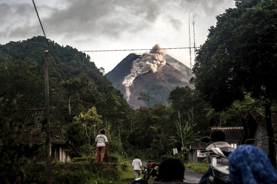 Indonesia's Mount Merapi has erupted, belching out hot ash clouds which travelled as far as three kilometres away from its crater - Agung Supriyanto / ©AFP