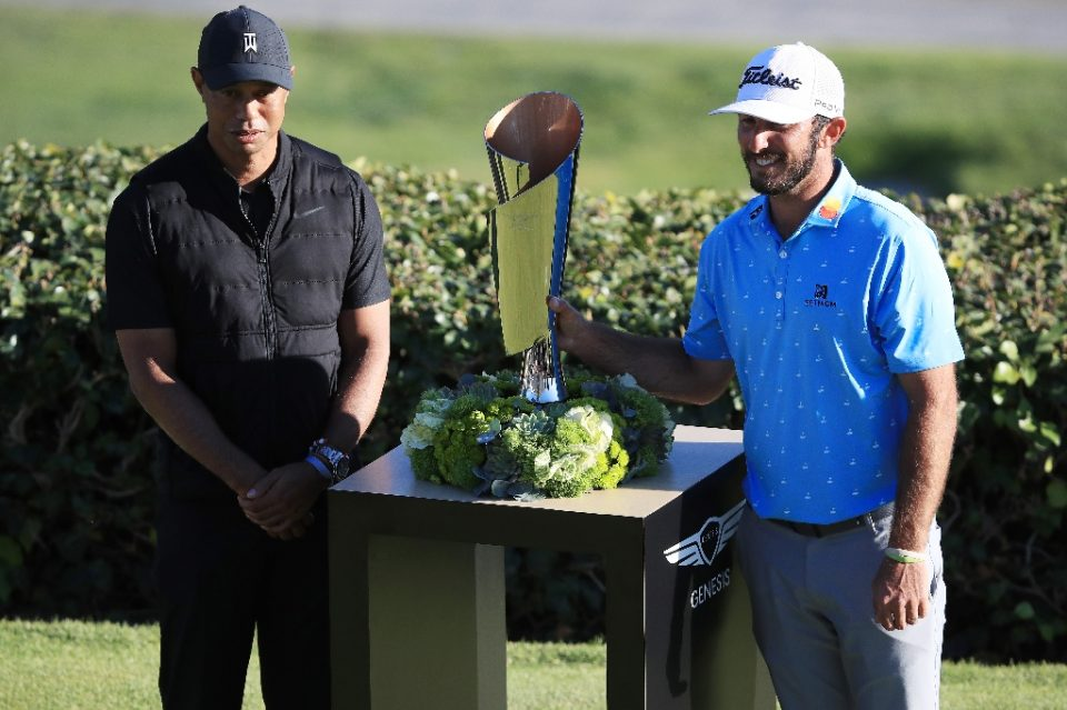 Tiger Woods, a 15-time major winner at left with 2021 PGA Genesis Invitational winner Max Homa, said Sunday he wants to play in April's Masters but isn't sure his surgically repaired back will be ready by then - Sean M. Haffey / ©AFP